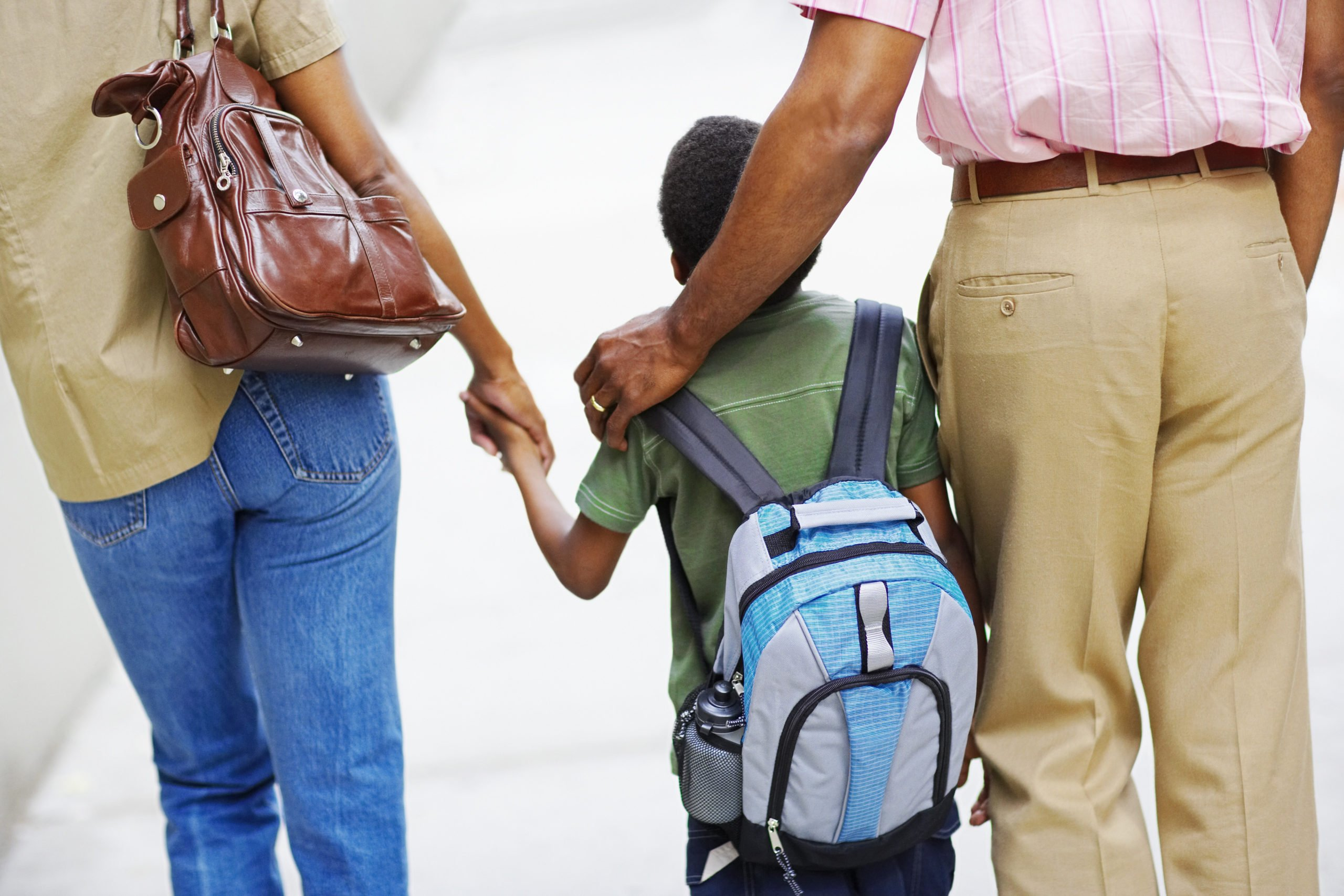 Parents Walking Son to School